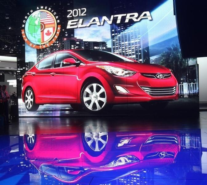 The North American Car of the Year, the 2012 Hyundai Elantra, is shown on a billboard during the first press preview day for the North American International Auto Show in Detroit