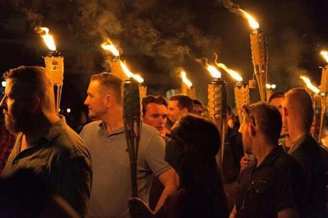 The mob of white nationalists carried flaming torches on the march, some making Nazi salutes and chanting 'You will not divide us.' Source: Reuters