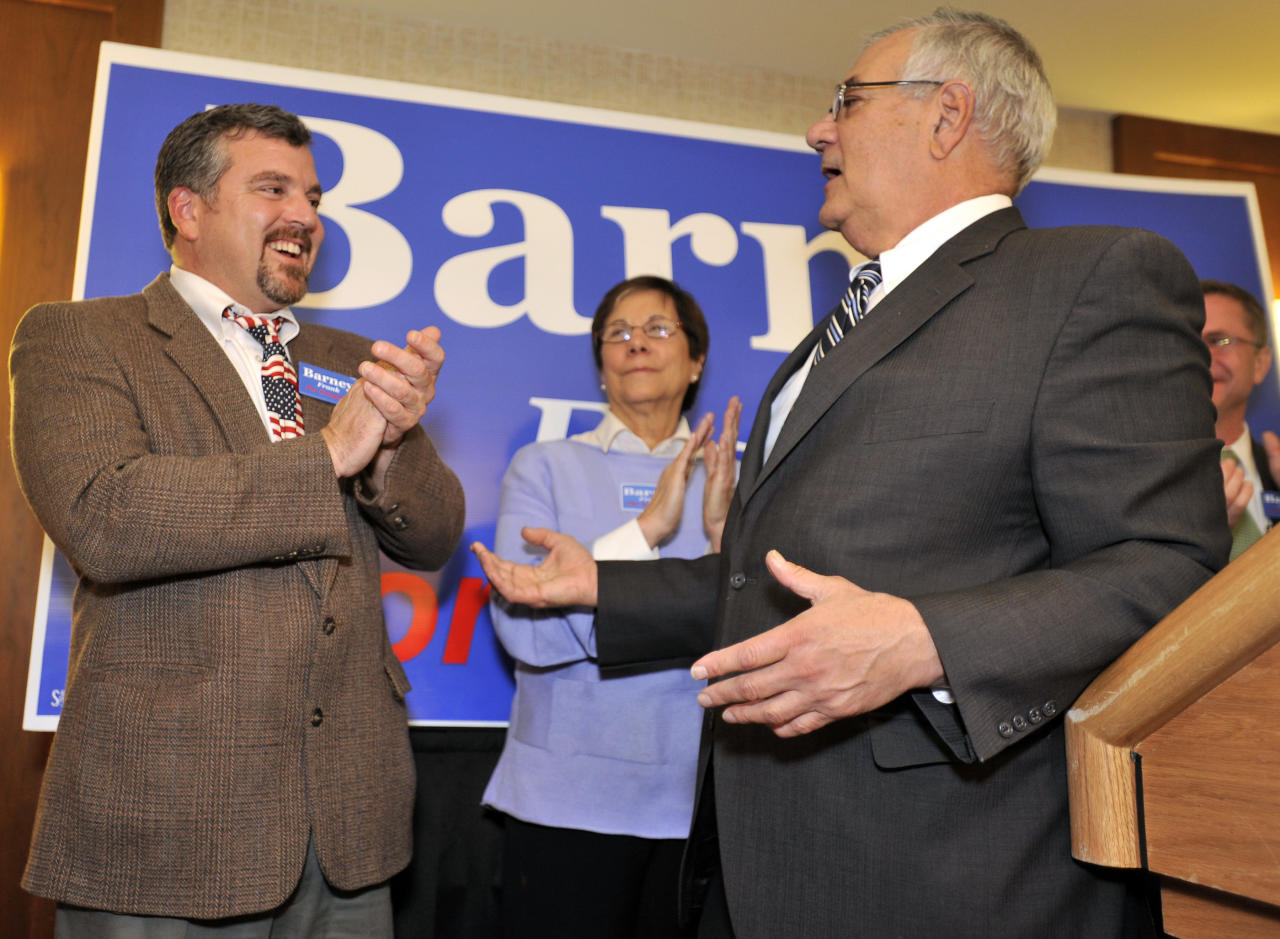 FILE - In this Nov. 2, 2010 file photo, Rep. Barney Frank, D-Mass., right, thanks his partner Jim Ready at a party in Newton, Mass., after Frank won re-election in the 4th Congressional District. A spokesman for Frank confirmed Thursday, Jan. 26, 2012, that Frank a gay pioneer in Congress, plans to marry Ready, his longtime partner from Maine. Frank is retiring from Congress at the end of the 2012 term. (AP Photo/Josh Reynolds, File)