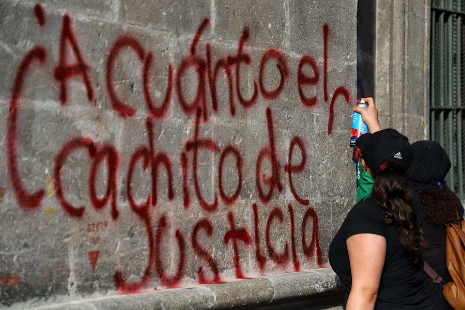 MEXICO CITY, MEXICO - JULY 20: A demonstrator writes in Spanish