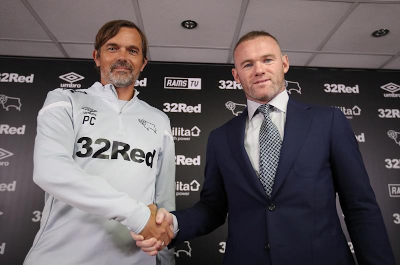 Soccer Football - Championship - Derby County - Wayne Rooney Press Conference - Pride Park, Derby, Britain - August 6, 2019 Derby County manager Phillip Cocu and Wayne Rooney pose during the press conference Action Images via Reuters/Carl Recine