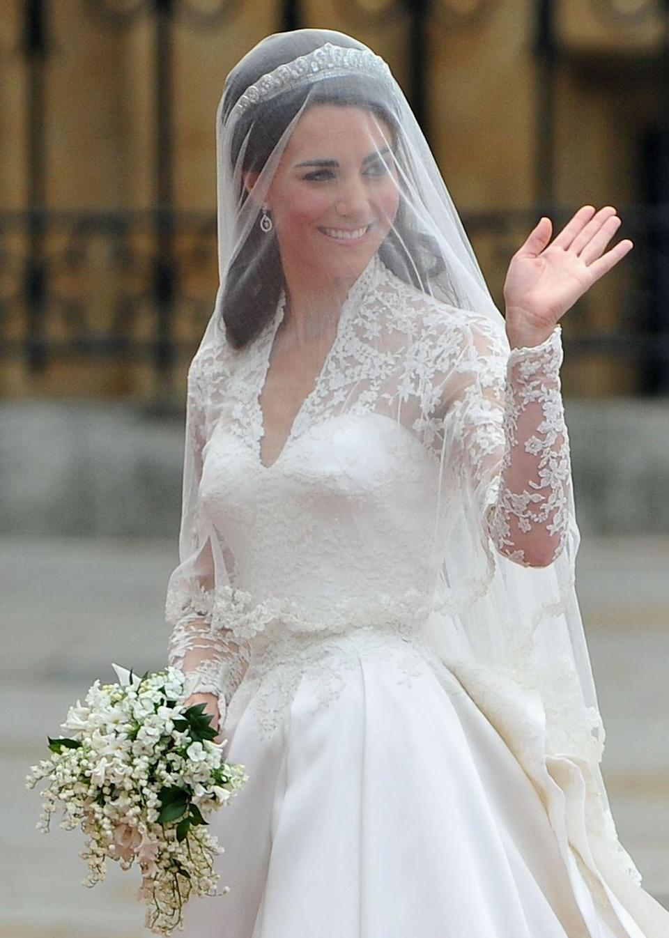 """<p>The Duchess of Cambridge had <a href=""""https://www.townandcountrymag.com/society/tradition/g20527984/meghan-markle-prince-harry-kate-middleton-prince-william-royal-wedding-differences-comparison/"""" rel=""""nofollow noopener"""" target=""""_blank"""" data-ylk=""""slk:flowers embroidered around the edge"""" class=""""link rapid-noclick-resp"""">flowers embroidered around the edge</a> of her veil to match her dress.</p>"""
