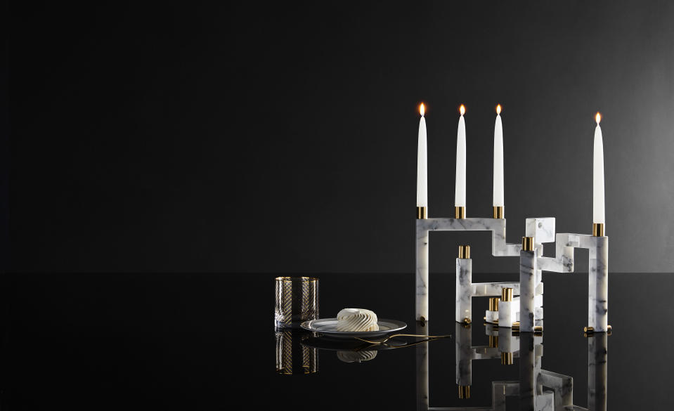 This image provided by Novita Italia shows a Vestalia white marble candlestick holder. Virginia Valentini and Francesco Breganze of the Italian studio LatoxLato have designed a clever candelabrum; they use a water jet to precisely cut small slabs of marble. Closed, the pieces look like a solid slab. But with a few light pushes, a series of candleholders accordions outward, creating an elegant objet d'art. (Novita Italia via AP)