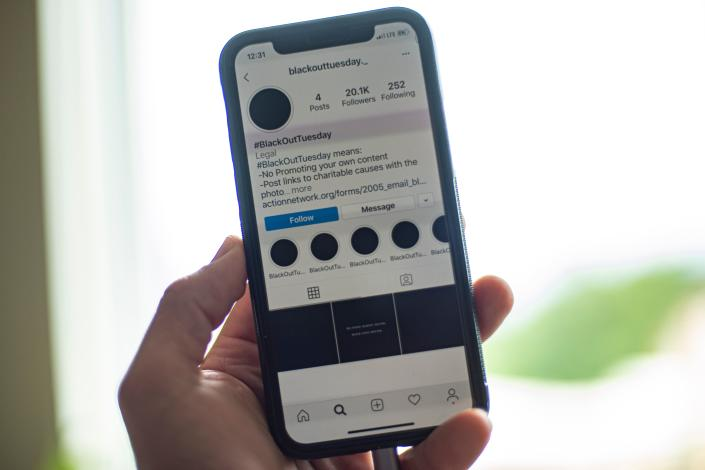 A smartphone displaying the Instagram #blackouttuesday account is seen in Washington on June 2, 2020.(Eric Baradat/AFP via Getty Images)
