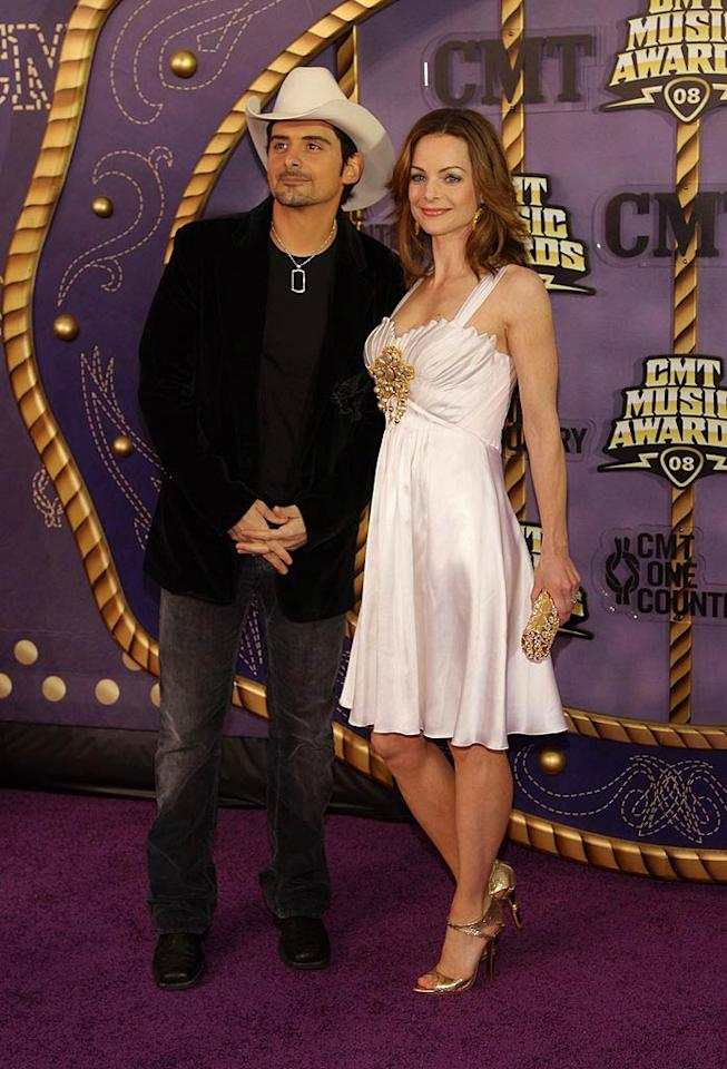"""Although Brad Paisley opted to wear a simple velvet blazer for the occasion, his wife Kimberly donned a white dress that would have been prettier without the distracting gold detail in front. Stephen Lovekin/<a href=""""http://www.gettyimages.com/"""" target=""""new"""">GettyImages.com</a> - April 14, 2008"""