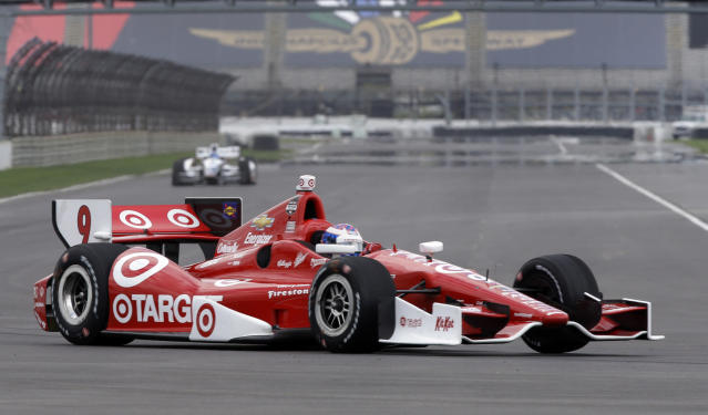 Scott Dixon, of New Zealand, takes a turn during testing for the inaugural Grand Prix of Indianapolis auto race on the new road course at Indianapolis Motor Speedway in Indianapolis, Wednesday, April 30, 2014. (AP Photo/Michael Conroy)