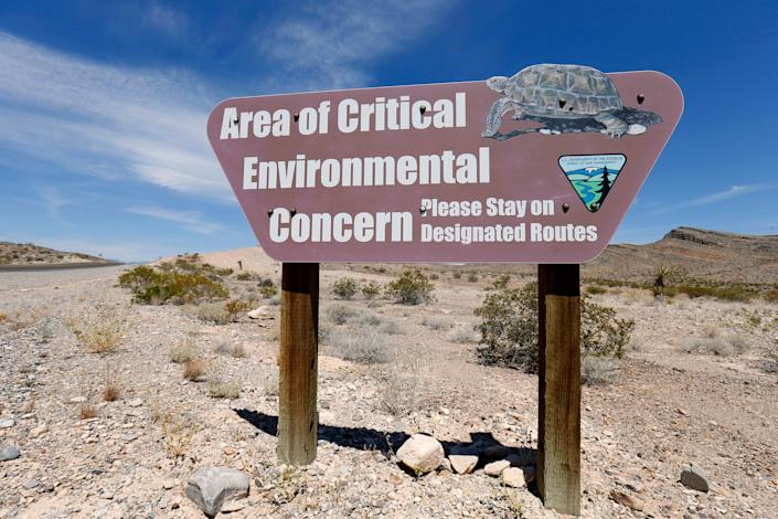 A Bureau of Land Management sign informs travelers along Highway 168, near Maopa, Nevada, to the habitat of the Mojave desert tortoise. (Photo: Mike Blake/Reuters)
