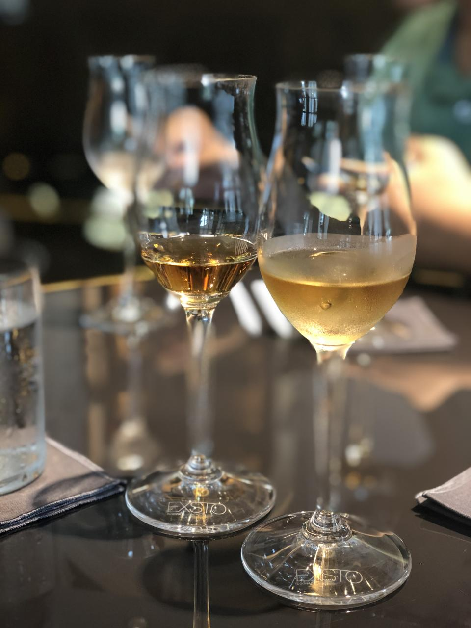 (From left to right) Sampling the Exsto Élixir, which contains 40% alcohol content, on its own and with an ice-cube. Adding ice-cubes will dilute the cognac and reduce the alcohol percentage, which in turn reveals the aromas while making the taste more refreshing. (PHOTO: Sheila Chiang/Yahoo Lifestyle Singapore)