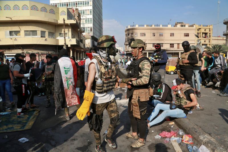 Anti-government protesters gather on Rasheed Street in Baghdad, Iraq, Wednesday, Nov. 27, 2019. Several protesters were killed by security forces who fired live rounds in Baghdad and southern Iraq amid ongoing violence and days of sit-ins and road closures, Iraqi officials said Wednesday. (AP Photo/Khalid Mohammed)