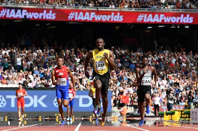 Jamaica's Usain Bolt (C) race to victory on the anchor leg ahead of Canada's Mobolade Ajomale (R) and Cuba's Jose Luis Gaspar to win their heat in the 4x100m relay at the IAAF World Championships at the London Stadium in London, on August 12, 2017 (AFP Photo/Jewel SAMAD)