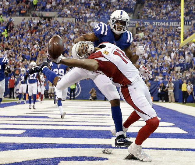 <p>Arizona Cardinals' Larry Fitzgerald (11) tries to make a catch while being defended by Indianapolis Colts' Rashaan Melvin during the first half of an NFL football game Sunday, Sept. 17, 2017, in Indianapolis. The pass was incomplete. (AP Photo/AJ Mast) </p>