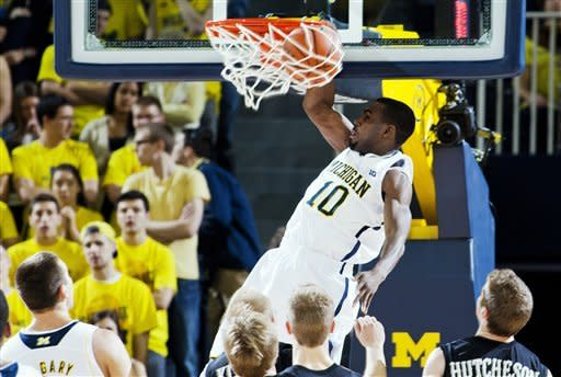 Michigan guard Tim Hardaway Jr., (10) dunks the ball in the first half of an NCAA college basketball game against Western Michigan, Tuesday, Dec. 4, 2012, at Crisler Center in Ann Arbor, Mich. (AP Photo/Tony Ding)