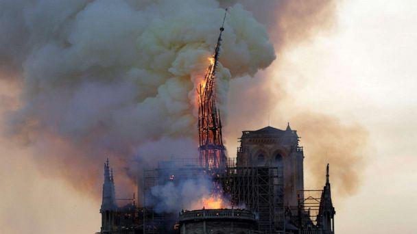 PHOTO: The steeple of the landmark Notre-Dame Cathedral collapses as the cathedral is engulfed in flames in Paris, April 15, 2019. (Geoffroy Van Der Hasselt/AFP/Getty Images)