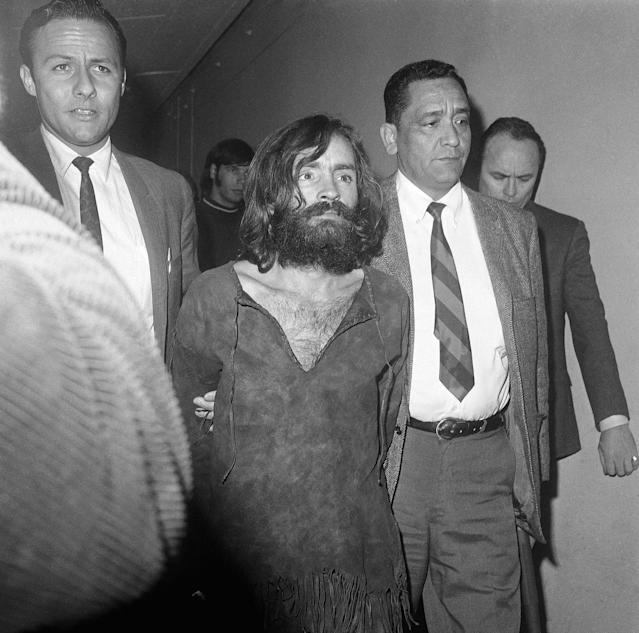 <p>Charles Manson, leader of a cult of hippies, is taken to court on Dec. 10, 1969, in Independence, Calif., for a preliminary hearing on charges of possessing stolen property. (Photo: Harold Filan/AP) </p>