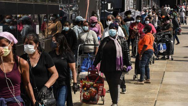 PHOTO: People wait on a long line to receive a food bank donation at the Barclays Center on May 15, 2020 in the Brooklyn borough in New York City. (Stephanie Keith/Getty Images)