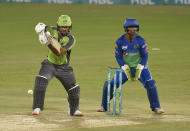 Lahore Qalandars batsman Fakhar Zaman, left, plays a shot while Multan Sultans wicketkeeper Zeeshan Ashraf watches during the second eliminator cricket match of Pakistan Super League T20 cup at National Stadium in Karachi, Pakistan, Sunday, Nov. 15, 2020. (AP Photo/Fareed Khan)