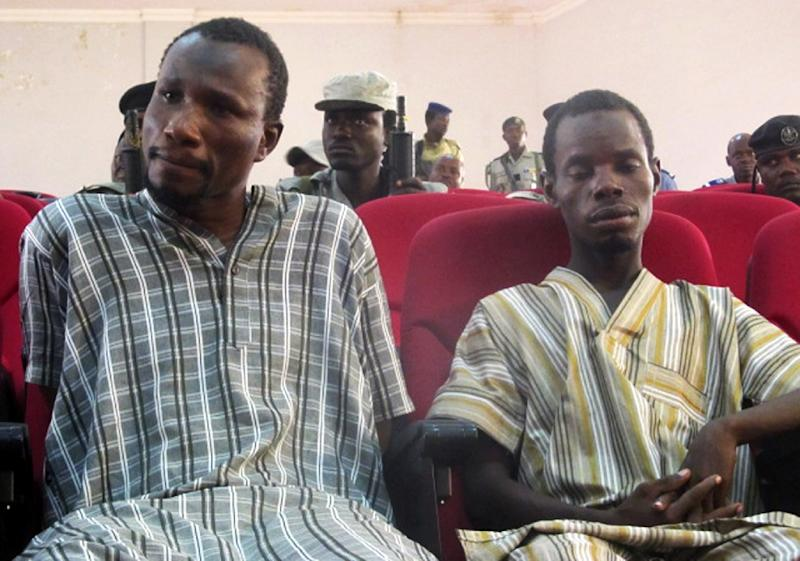 A picture taken on August 26, 2015 shows suspected members of Nigeria-based Islamist group Boko Haram sitting in court in N'Djamena, during the opening of the trial of ten suspected Boko Haram members (AFP Photo/)