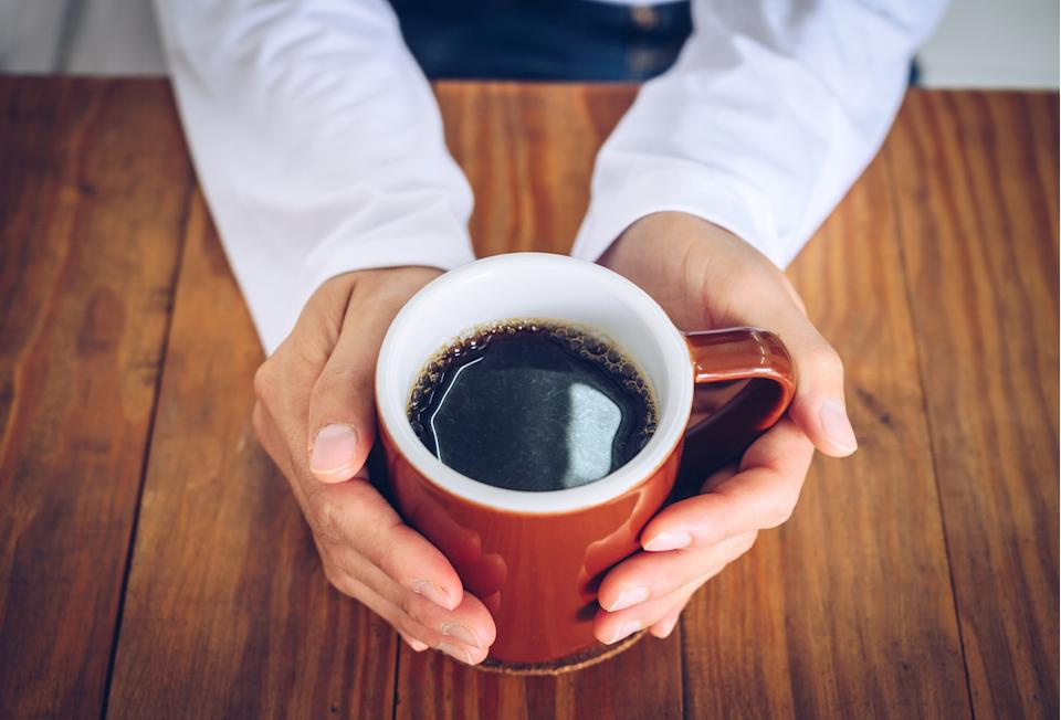 Keep your coffee hot with the PG mug warmer from Amazon. (Image via Getty Images)