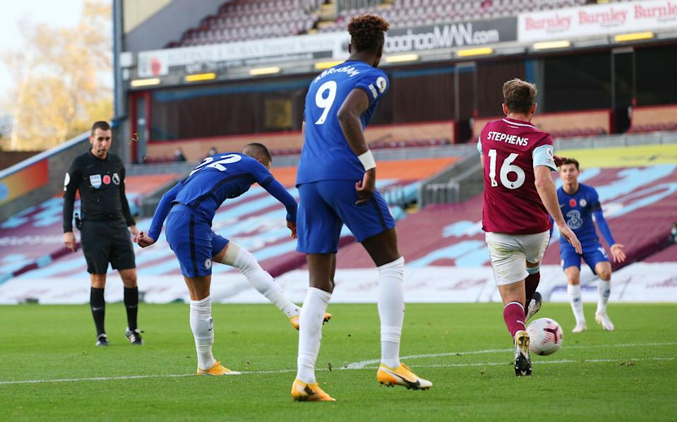 <p>Hakim Ziyech fires a shot at goal to score Chelsea's opener</p> (Reuters)