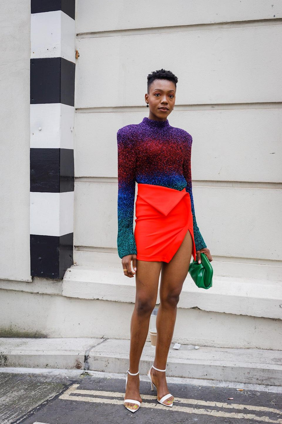 """Teaming a red skirt with a stunning multicoloured top? This show-goer understood the assignment. <span class=""""copyright"""">Photo Courtesy of Tristan Fewings/Getty Images. </span>"""