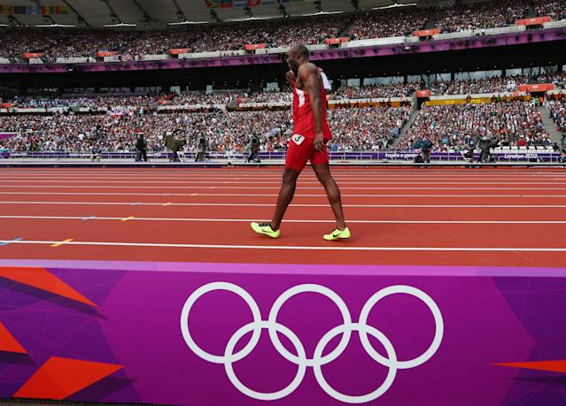 Lashawn Merritt of the United States pulls out with a hamstring injury in the Men's 400m Round 1 Heats on Day 8 of the London 2012 Olympic Games at Olympic Stadium on August 4, 2012 in London, England. (Photo by Alexander Hassenstein/Getty Images)