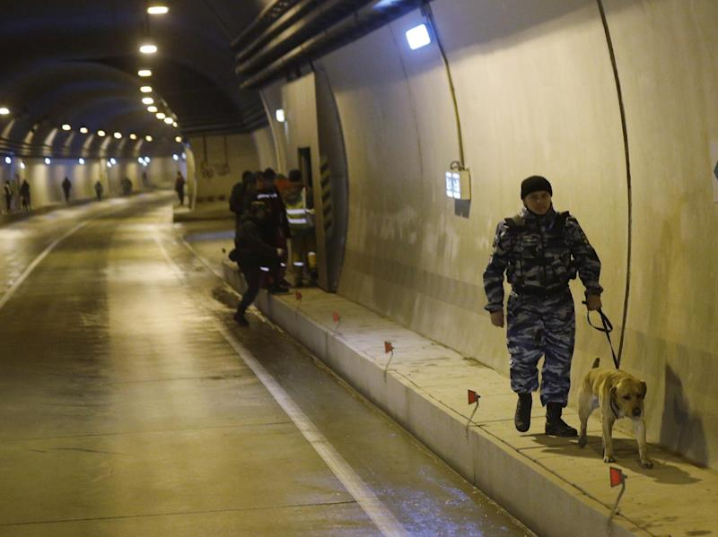 Russian police inspect a tunnel on the road between and Krasnaya as increased security measures are put into place ahead of the 2014 Winter Olympics, Thursday, Jan. 30, 2014, in Krasnaya Polyana, Russia. Outdor snow sports and sliding track events will take place in Krasnaya Polyana. (AP Photo/Luca Bruno)
