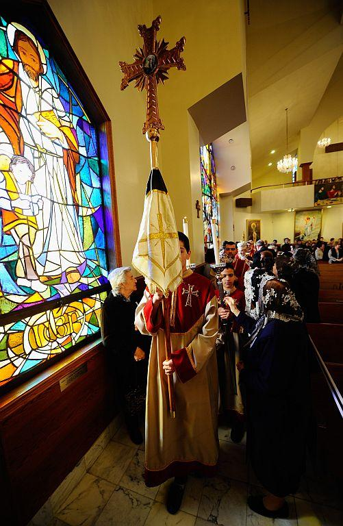 LOS ANGELES, CA:  Parishioners touch the veil of the cross during a procession at St. Garabed Armenian Apostolic Church during Christmas mass in Los Angeles, California. Many eastern Christian churches, including the Armenian Church, celebrate January 7 as both the birth and baptism of Jesus Christ. File photo: 2011