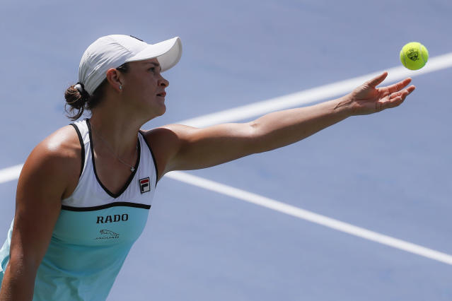Ashleigh Barty, of Australia, serves to Anett Kontaveit, of Estonia, during the quarterfinals of the Western & Southern Open tennis tournament, Thursday, Aug. 15, 2019, in Mason, Ohio. (AP Photo/John Minchillo)