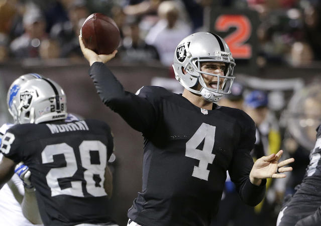 Oakland Raiders quarterback Derek Carr passes against the Detroit Lions during the second half of an NFL preseason football game in Oakland, Calif., Friday, Aug. 15, 2014. (AP Photo/Marcio Jose Sanchez)