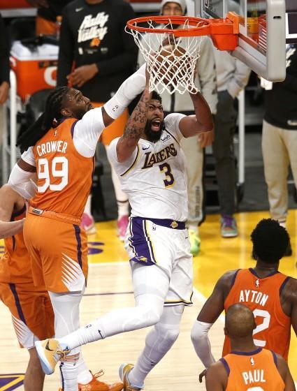 LOS ANGELES, CA - MAY 30: Los Angeles Lakers forward Anthony Davis (3) misses a layup guarded Phoenix Suns.