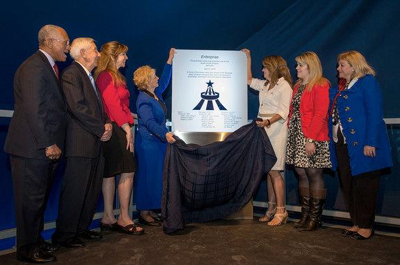 June Scobee Rodgers and Sheryl Chaffee help to reveal a plaque dedicating the Intrepid Sea Air & Space Museum's exhibit of the space shuttle Enterprise to the fallen Apollo 1, STS-51L and STS-107 astronauts, including their family members. With