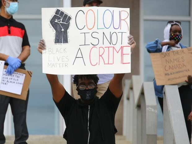 People gathered on the steps of the Confederation Building on June 6, 2020, to stand in solidarity with the Black Lives Matter movement.