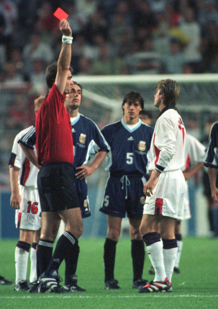FILE - In this June 30, 1998 file photo, England's David Beckham receives a red card from Danish referee Kim Milton Nielsen, during England's World Cup second round soccer match against Argentina, in Saint Etienne, France. (AP Photo/Denis Doyle, File)