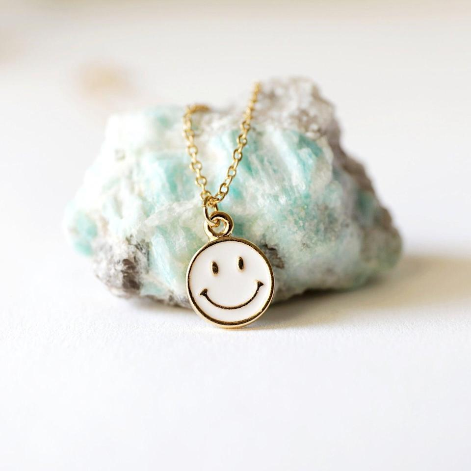 <p>Get classy with your '90s jewelry by donning this <span>Smiley Face Necklace</span> ($15). </p>