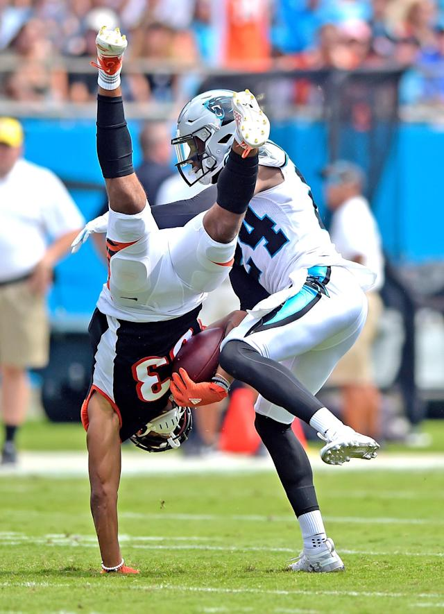 <p>Cincinnati Bengals' Tyler Boyd (83) is upended by Carolina Panthers' James Bradberry (24) during the first half of an NFL football game in Charlotte, N.C., Sunday, Sept. 23, 2018. (AP Photo/Mike McCarn) </p>