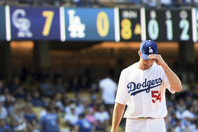 Los Angeles Dodgers relief pitcher Tony Cingrani adjusts his cap as the Colorado Rockies open a big lead in the eighth inning of a baseball game, Sunday, Sept. 10, 2017, in Los Angeles. (AP Photo/Michael Owen Baker)