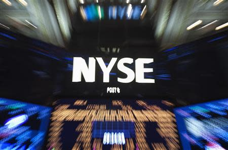 "The logo of the New York Stock Exchange is pictured in this ""zoom effect"" photo from the floor of the exchange in New York, October 14, 2013. REUTERS/Carlo Allegri"