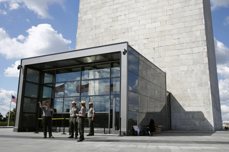 National Parks Service park rangers gather outside a new security screening building at the foot of the Washington Monument during a preview tour ahead of the monument's official reopening, Wednesday, Sept. 18, 2019, in Washington. The monument, which has been closed to the public since August 2016, is scheduled to re-open Thursday, Sept. 19. (AP Photo/Patrick Semansky)
