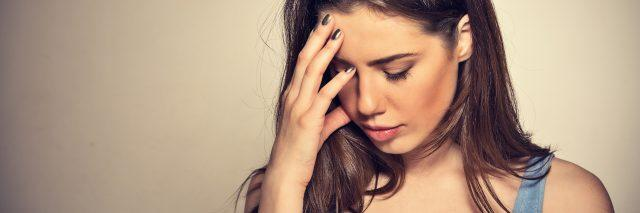 young woman stressed with hand on head