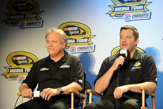 CHARLOTTE, NC - JANUARY 27: Tony Stewart (right), co-owner of Stewart-Haas Racing and driver of the #14 Bass Pro Shops Chevrolet, and Gene Haas, co-owner of Stewart-Haas Racing, speak with the media during NASCAR Sprint Media Tour at Charlotte Convention Center on January 27, 2014 in Charlotte, North Carolina. (Photo by Jared C. Tilton/Getty Images)