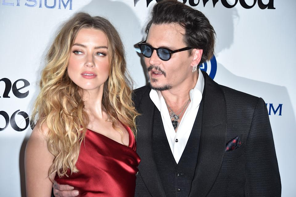 CULVER CITY, CA - JANUARY 09:  Amber Heard and Johnny Depp attend the Art of Elysium 2016 HEAVEN Gala presented by Vivienne Westwood & Andreas Kronthaler at 3LABS on January 9, 2016 in Culver City, California.  (Photo by George Pimentel/WireImage)