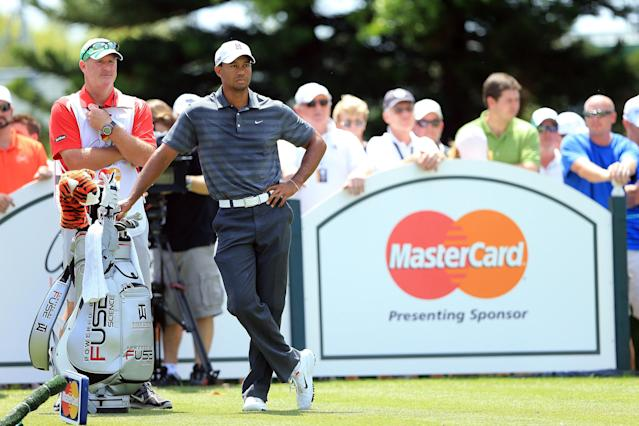 ORLANDO, FL - MARCH 24: Tiger Woods of the USA waits on the tee with his caddie Joe LaCava to play his tee shot at the par 3, second hole during the third round of the 2012 Arnold Palmer Invitational presented by MasterCard at Bay Hill Club and Lodge on March 24, 2012 in Orlando, Florida. (Photo by David Cannon/Getty Images)