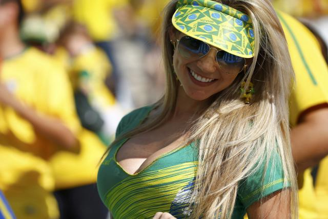 A Brazilian fan attends the opening ceremony of the 2014 World Cup at the Corinthians arena in Sao Paulo June 12, 2014. REUTERS/Kai Pfaffenbach (BRAZIL - Tags: SOCCER SPORT WORLD CUP SOCIETY)