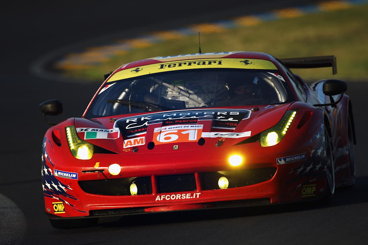 LE MANS, FRANCE - JUNE 17:  The AF - Corse Michael Waltrip Racing Ferrari 458 of Robert Kauffman, Rui Aguas and Brian Vickers in action during Le Mans 24 Hour race at the Circuit de la Sarthe on June 17, 2012 in Le Mans, France.  (Photo by Bryn Lennon/Getty Images)