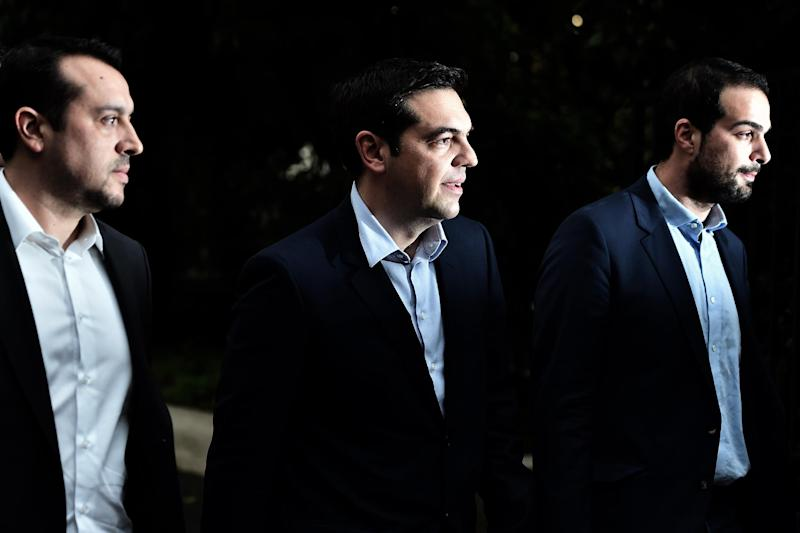 Newly appointed Greek Prime Minister Alexis Tsipras (C) leaves his office in Athens, Greece on January 27, 2015