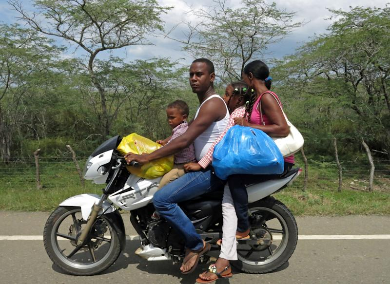 In this July 15, 2013 photo, a family of four travel on a motorcycle on the road between Dajabon and Montecristi, Dominican Republic. The Dominican Republic is effectively the deadliest nation anywhere for drivers, second only to the tiny South Pacific island of Niue, where each death among its roughly 1,400 inhabitants spikes the fatality average. For every 100,000 inhabitants in the Dominican Republic, 42 die every year from traffic accidents, according to the World Health Organization. (AP Photo/Ezequiel Abiu Lopez)