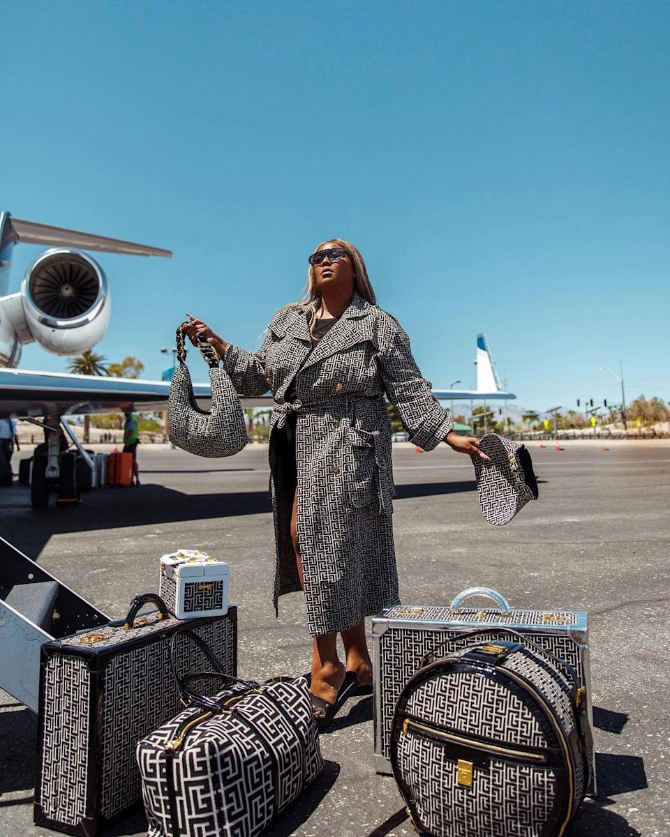 Lizzo celebrated her 33rd birthday in style. The musician ended her birthday weekend in Las Vegas by turning the airport into a runway, with a matching Balmain trench coat, hat, and the entire luggage set.