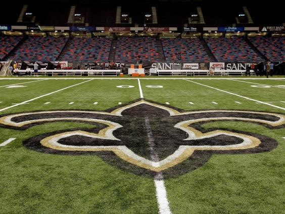 Ties between local church leaders and the Saints include a close friendship between New Orleans Archbishop Gregory Aymond and Gayle Benson, who inherited the Saint (Getty Images)