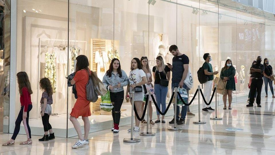 Shoppers queue in Westfield Shopping centre on June 15, 2020 in London, England.