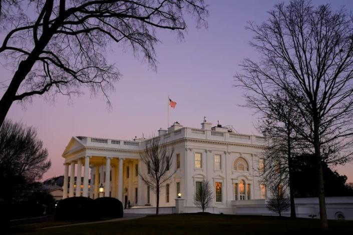 FILE PHOTO: The White House is seen at sunset on U.S. President Joe Biden's first day in office in Washington